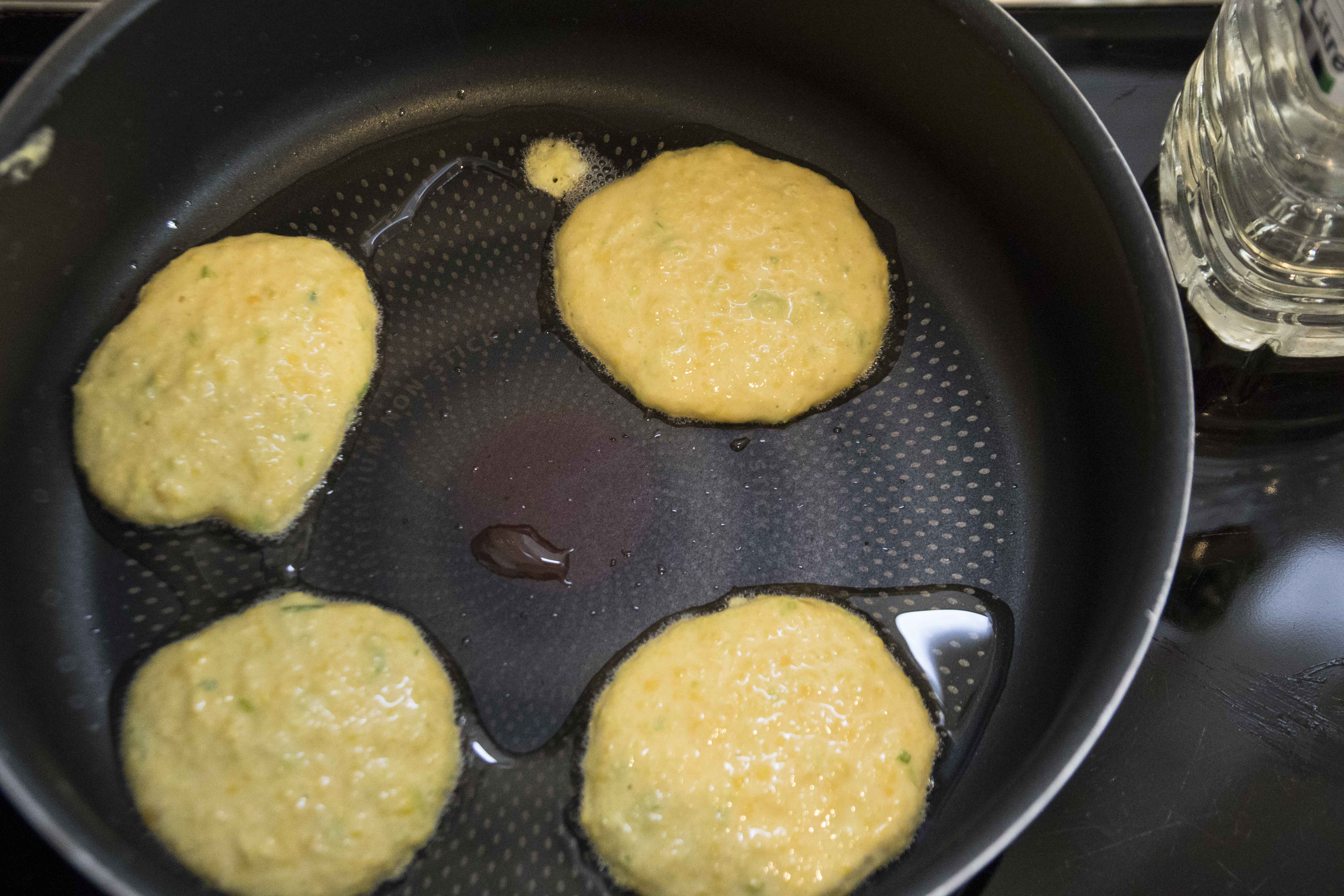 Cooking the sweetcorn fritters
